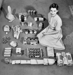 Portrait of housewife Ann Cox Williams (1915 - 2011) as she poses with a week's worth of groceries, Atlanta, Georgia 1947. Williams was featured in a newspaper article and then Life magzine story for her ability to feed her family of four, plus a cat, on only $12.50 (with extra money for milk) per week. (Photo by Robert Wheeler/Time & Life Pictures/Getty Images)
